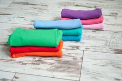 Bright clothes stacked. With piles Royalty Free Stock Image