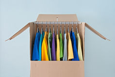 Bright clothing in a wardrobe box for easy moving Royalty Free Stock Photography