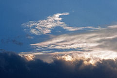BRIGHT CLOUDS. Longitudinal white clouds in blue evening sky royalty free stock photos