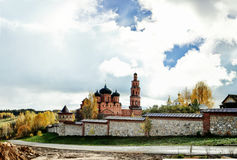 Bright cloudy sky over Orthodox monastery in autumn Stock Photo