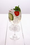 Bright cocktail with cucumber, strawberry in wine glass Royalty Free Stock Image