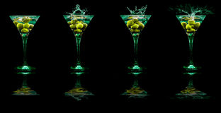 Bright  cocktails in glasses Stock Photos