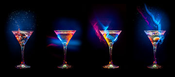 Bright cocktails in glasses royalty free stock image