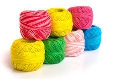 Bright coils of yarn. Multicolored skeins of yarn are laid out in a double row Royalty Free Stock Image