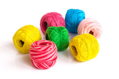 Bright coils of yarn. Multicolored skeins of yarn are randomly scattered on the surface Stock Photos