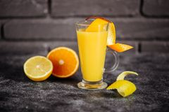 Bright cold summer tropical alcohol orange coctail of ripe oranges royalty free stock photos