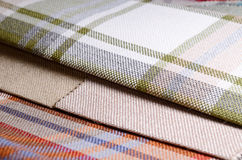 Bright collection of colorful gunny textile samples. Fabric texture background Royalty Free Stock Photo