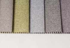 Bright collection of gunny textile samples. Fabric texture background. Stock Photo