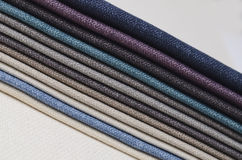 Bright collection of gunny textile samples. Fabric texture background. Stock Photography