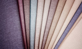 Bright collection of gunny textile samples. Fabric texture background. Stock Images