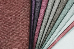 Bright collection of gunny textile samples. Fabric texture background. Stock Image