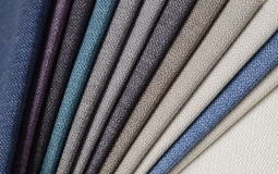 Bright collection of gunny textile samples. Fabric texture background. Royalty Free Stock Photos