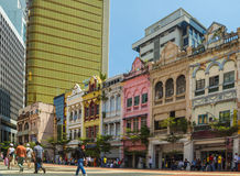 Bright colonial buildings in Kuala Lumpur center. City center with small colorful buildings and the street Stock Photo