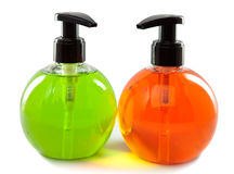 Green and orange liquid soap on a white background Royalty Free Stock Image