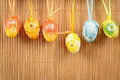 Bright color easter eggs with bows Royalty Free Stock Image
