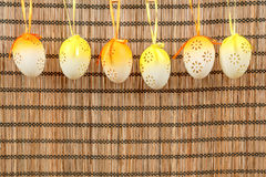 Bright color easter eggs with bows Stock Photos