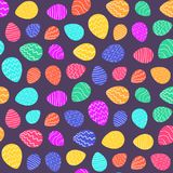 Bright color Easter pattern with cartoon eggs. Bright color Easter seamless pattern with cartoon decorated eggs on dark purple background. Ornate doodle eggs Royalty Free Stock Images