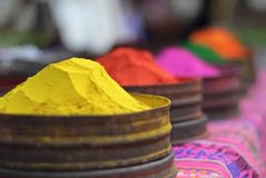 Bright color paint is sold at peruvian market. Visiting the Pisac market at Peru, beautiful colorful textile paint is one of the many things that were worth royalty free stock image