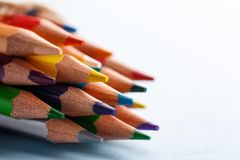 Bright color palette of crayons on the table. Pile of sharp coloured drawing pencils on table. Abstract background from color pencils. copyspace royalty free stock photo