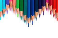 Bright color pencils horizontal wave on white background pointing downward royalty free stock images