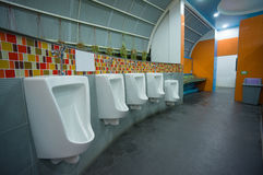 Bright color public toilet on gas station in asia Stock Photo