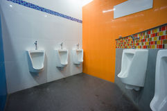 Bright color public toilet on gas station in asia Royalty Free Stock Photography