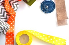 Bright color ribons and pins on white background, flat lay. Bright color ribons and set of pins on white background, flat lay royalty free stock image