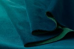 Bright color of seawave velour textile sample. Fabric texture background Stock Images