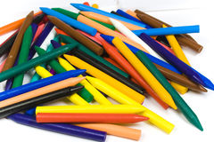 The bright color wax pencils heaped. On white stock photos