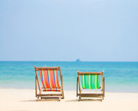 Bright color wooden beach chairs on island tropical beach Stock Photography