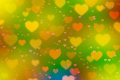 Bright colored background with hearts of different colors, blurr. Blurred surface with bright color background and heart symbol image of different color and size Royalty Free Illustration