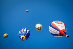 Bright colored balloons in blue sky Royalty Free Stock Photo