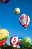 Bright colored balloons fly in blue sky Royalty Free Stock Photo