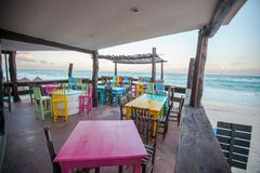 Bright colored bar-restaurant on the white sandy Royalty Free Stock Photos