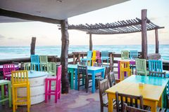 Bright colored bar-restaurant on the white sandy Royalty Free Stock Photography
