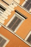 Bright colored building. Colorful building and windows in Rome, Italy Stock Images