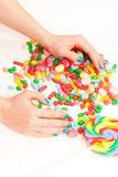 Candy and hands Royalty Free Stock Images