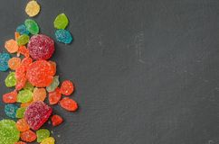Bright colored candy, sweets, sweets on a dark background Royalty Free Stock Photos