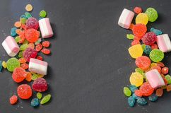 Bright colored candy, sweets, sweets on a dark background Stock Photo