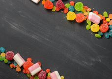 Bright colored candy, sweets, sweets on a dark background Royalty Free Stock Image