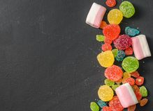 Bright colored candy, sweets, sweets on a dark background Stock Image