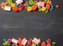 Bright colored candy, sweets, sweets on a dark background Stock Images