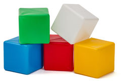 Bright colored childrens cubes, isolated on white background royalty free stock photos