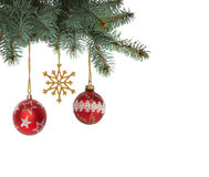 Bright colored Christmas balls and snowflake hanging from Christmas trees Stock Photo