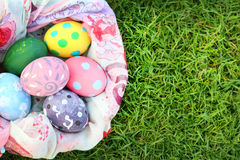 Bright colored eggs and beautiful cloth on grass on Easter day. Bright color eggs and beautiful cloth on grass on Easter day Royalty Free Stock Photography