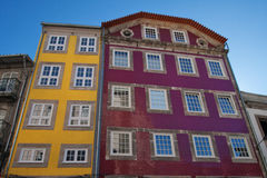 Bright colored facades of buildings. Walking the streets of Porto. Ancient district of the city. Yellow and red facades. Painted houses Stock Photos