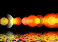Bright colored flare. Bright colored flare reflected in the water surface Stock Photo