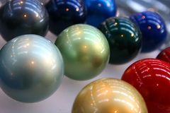 Bright colored globes. Shiny colorfull balls in a trade show Stock Photos