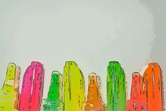Bright markers and tubes of paint on a light background. stock photography