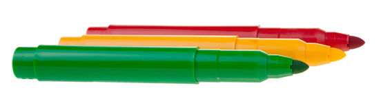 Bright colored markers on white background Royalty Free Stock Images